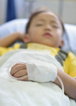 electrolyte: Intra venous fluid line at left arm of boy patient. Stock Photo
