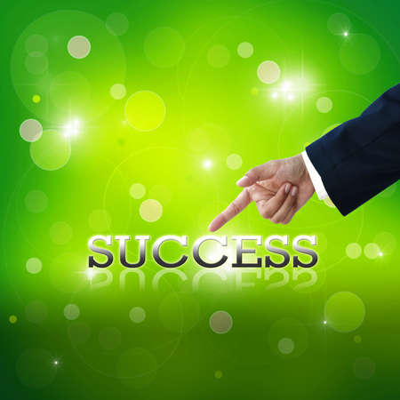 Selecting business hand with business wording on green abstract background. Stock Photo - 14451275