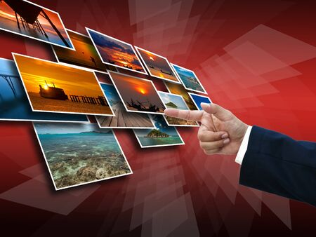 Business hand selecting business icon on medern red abstract background. Stock Photo
