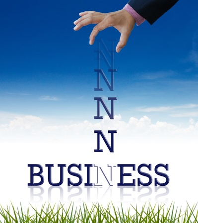 Artwork of business wording with dropping letter from business hand. photo