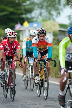 SURATTHANI, THAILAND - JULY 8: Unknown riders in action during Suratthani bike race 2012 at Suratthani on July 8, 2012 in Suratthani, Thailand.