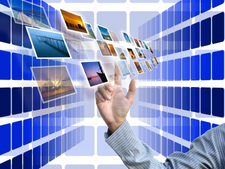selecting by business hand with businessideas on blue perspective abstract background. Stock Photo - 14694495