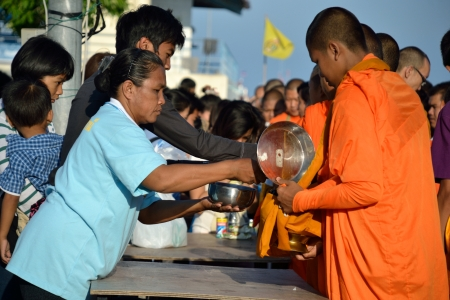 KO SAMUI - AUGUST 12: Buddhist monks walk collecting alms in the morning on the queen's birthday on August 12, 2012 in Ko samui, Thailand. Stock Photo - 14803252