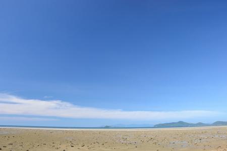 Clean clear blue sky with the beach. photo