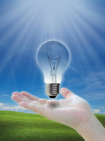 Conventional light bulb on nature abstract background. photo