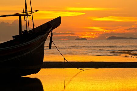 Golden sky during sunset at the beach. Stock Photo - 14868948