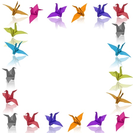 colorful paper birds with reflection on white background. photo