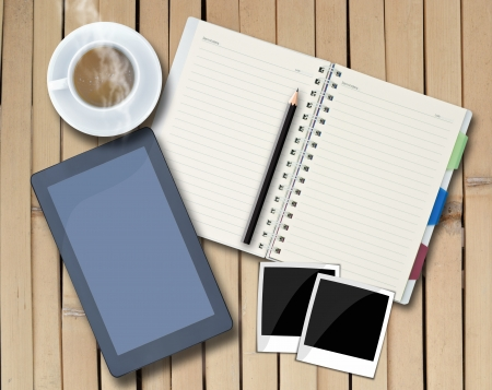 Office objects , notepad, tablet computer, photo frames,\ coffee cup on background.