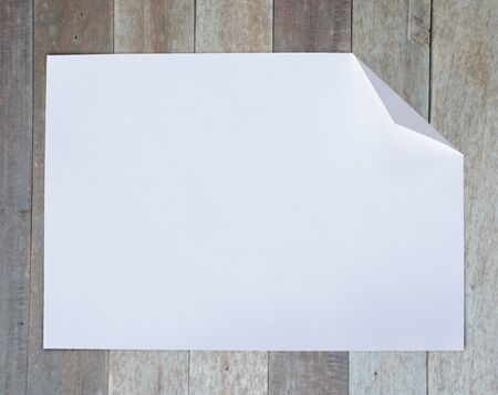 Folded empty white paper on background. photo
