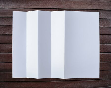 Folded empty white paper on background. Stock Photo - 15273317
