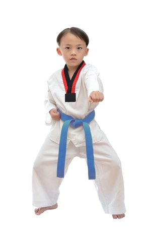 Taekwondo boy uniform in action isolated on white background  photo