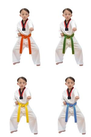 tae kwon do: Taekwondo boy uniform in action isolated on white background  Stock Photo
