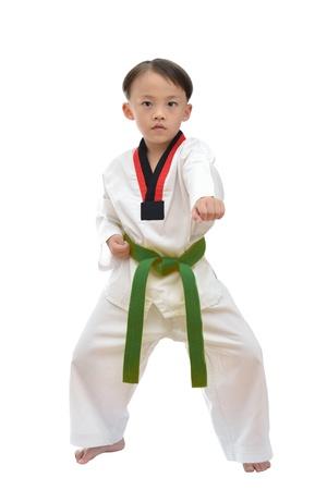 Taekwondo boy uniform in action isolated on white background  版權商用圖片