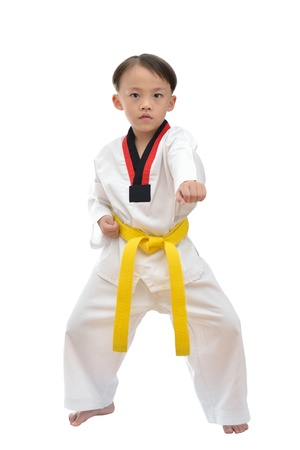 Taekwondo boy uniform in action isolated on white background  Фото со стока