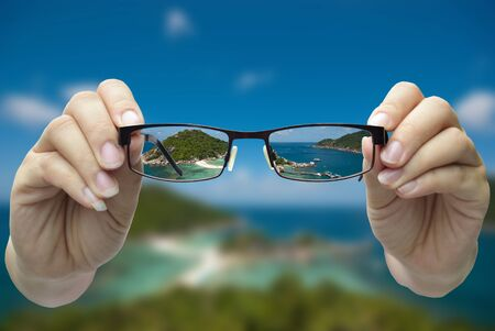 hyperopia: vision concepts by clear view eye glasses with out of focus background.