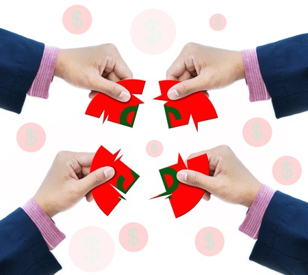 Make money with business hand and dollar sign jigsaw game. photo