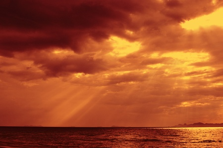 Amazing sun beams over the ocean. photo