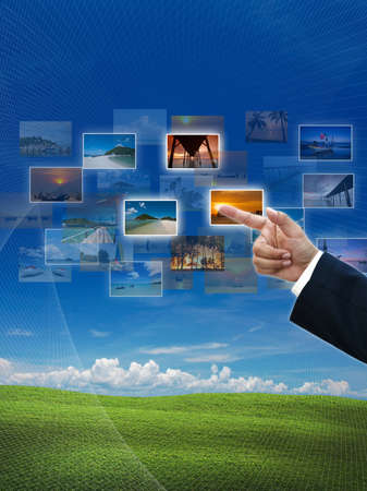 business hand selecting business icon on nature background. photo
