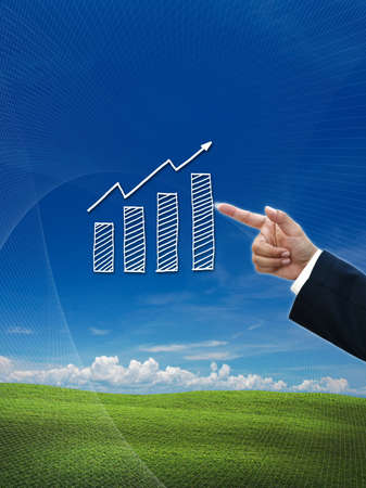 business hand selecting business icon on nature background. Stock Photo