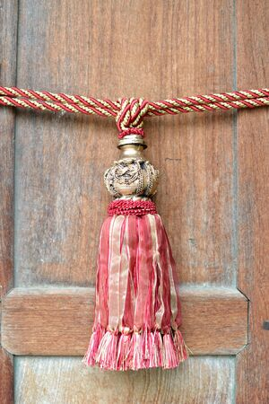 Close up of classic ancient style door rope with wooden door. photo