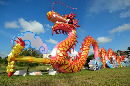 Colorful decorated dragon against blue sky. photo
