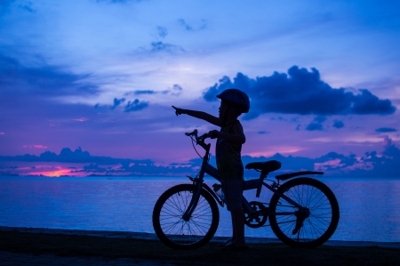 silhouette of small boy on bike at dusk. Stock Photo - 16183043