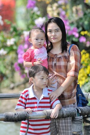 Asian family in th flower garden shallow depth of focus. photo