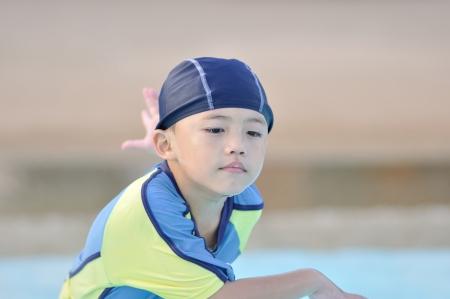 Cute asian boy with swim suit. photo