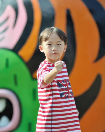 Cute asian boy at the playground. photo