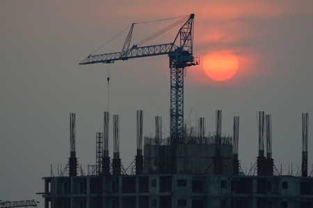 The building construction with sunset photo