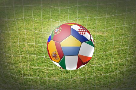 kickoff: soccer ball with net background. Stock Photo