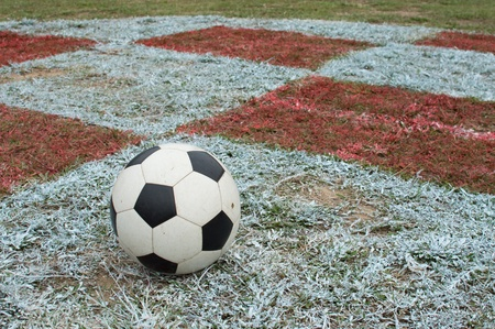 Soccer ball with rural field. photo
