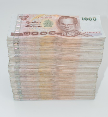 Stack of thai banknotes, one thousand bath type. photo