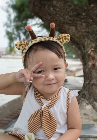 hair band: Cute asian girl with hair band portrait. Stock Photo