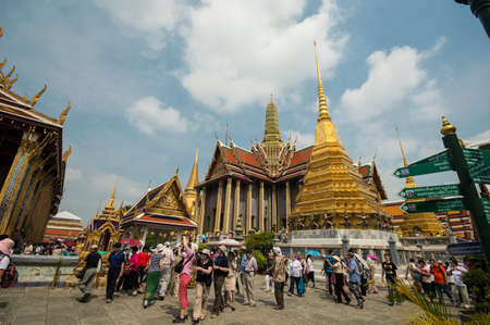 BANGKOK THAILAND - MARCH 30 : Traveller at the Palace or Temple of the Emerald Buddha (also called Wat Phra Kaew) on March 30, 2013 in Bangkok, Thailand. Stock Photo - 19075171