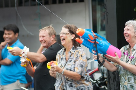 KO SAMUI, THAILAND - APRIL 13: Foreigners and Thai people enjoy splashing water together in songkran festival on April 13, 2013 in Ko Samui island, Thailand.