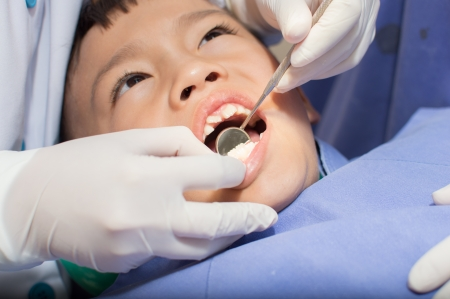 Asain kid at the dentist clinic. photo