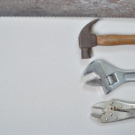 Work tools on gray recycled paper background. photo
