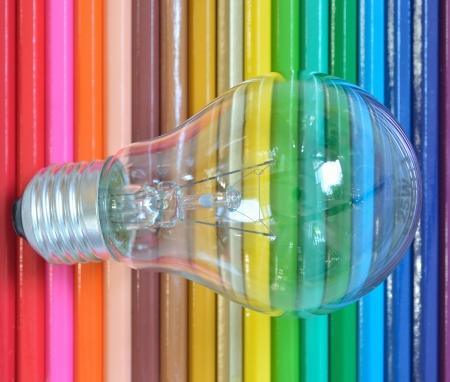 Close up of retro classic light bulb color pencil background. photo