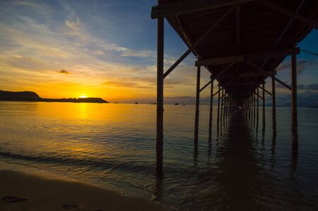 bangrak: sunset seascape at old wood pier, ko samui, thailand.