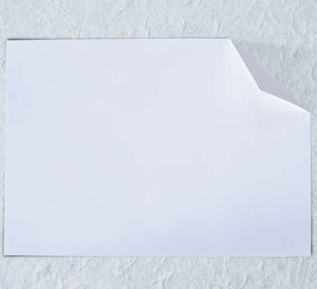 rundown: Folded empty white paper on background. Stock Photo
