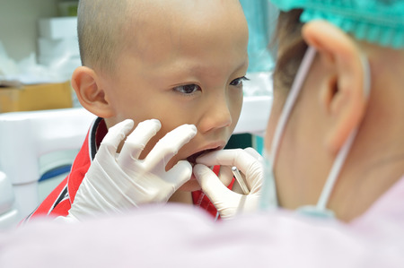 Young asian boy during dental examination. photo