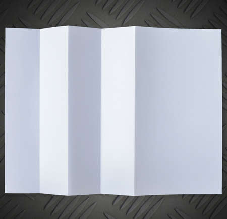 sandpaper: Folded empty white paper on background. Stock Photo
