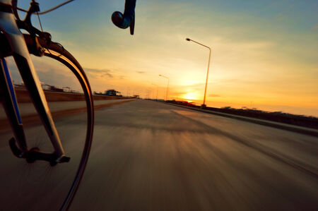 blurr: Riding to the target with motion blurr roadbike to the sunset. Stock Photo