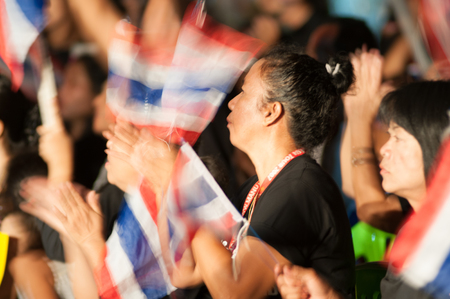 contentious: KO SAMUI - NOV 6: An unidentified anti-government protester joins a several hundred strong rally in opposition to a contentious government sponsored amnesty bill on Nov 6, 2013 in Ko samui, Suratthani, Thailand.