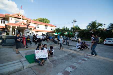 demonstrators: KOSAMUI,THAILAND-NOVEMBER 11 : Unidentified demonstrators from the anti- government  group wearing black shirt in front of government district office on November 3,2013 in Ko Samui,Thailand.