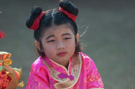 8 years old: KO SAMUI, THAILAND - FEBRUARY 8: Unidentified child 5 - 10 years old in Ko samui chinese newyear festival on February 8, 2014 in Ko samui, Thailand. Editorial