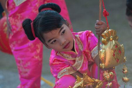 5 10 years old: KO SAMUI, THAILAND - FEBRUARY 8: Unidentified child 5 - 10 years old in Ko samui chinese newyear festival on February 8, 2014 in Ko samui, Thailand. Editorial