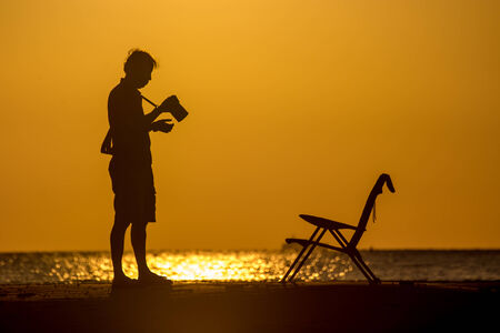silhouette of photographer at dusk. photo