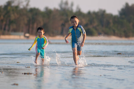 Cute asian kid with swimming suit activity. photo